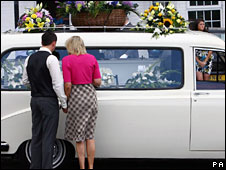Sally and Jamie Knox next to the funeral car