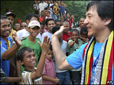 Hollywood star Jackie Chan meets young people in Dili, East Timor, on Wednesday