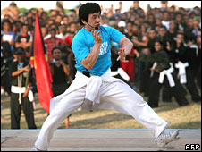 Hollywood star Jackie Chan demonstrates martial arts moves at the national stadium in Dili, East Timor, on Wednesday