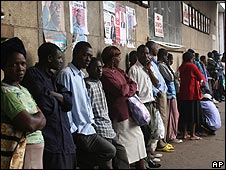 Zimbabweans queuing for bread outside a supermarket in Harare