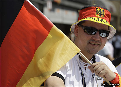 A German fan waves a flag