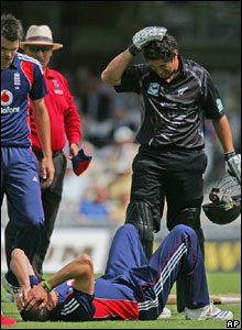 Ross Taylor (right) and Kevin Pietersen (below) hold their heads after a collision