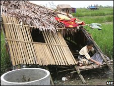 A survivor of Cyclone Nargis is seen in a makeshift shelter in Tontay