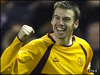 Paul Quinn celebrates scoring for Motherwell at Ibrox