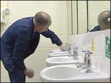 Cleaner in school toilets (generic)