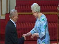 Ivor Powell is presented with his MBE by Her Majesty the Queen