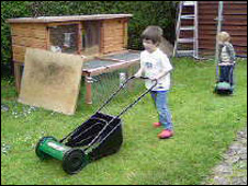 Samuel and Alex Buswell with their mowers