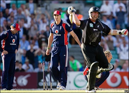 Mark Gillespie (right) celebrates as England fail to back up a throw, allowing him a second run
