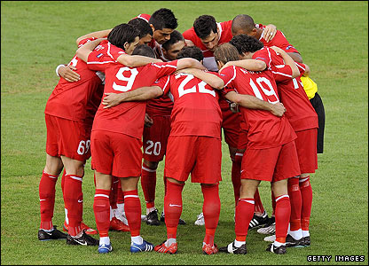 Turkey's players gather in a huddle