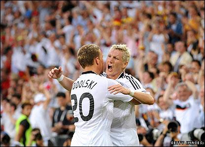 Germany's Lukas Podolski congratulates Bastian Schweinsteiger