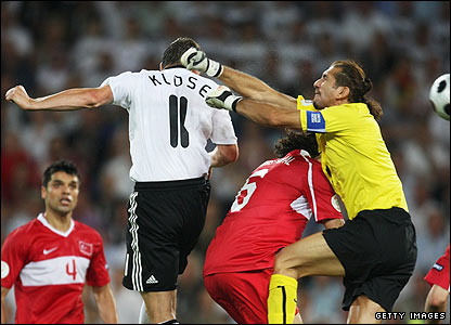 Rustu Recber misses his punch and is beaten to the ball by Germany's Miroslav Klose
