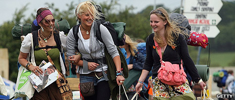 Festival goers arrive at Glastonbury