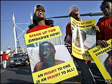 Zimbabweans and South Africans demonstrate against election related violence in Zimbabwe in Johannesburg
