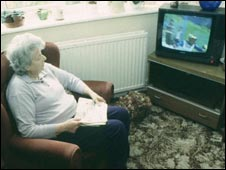 Pensioner watching television