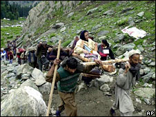 An Indian Hindu Pilgrim is carried to the Amaranth caves - 2001 AP picture