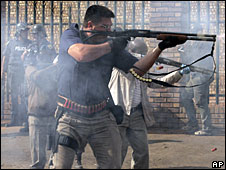 File photo of metro police firing rubber bullets outside Johannesburg in May 2008