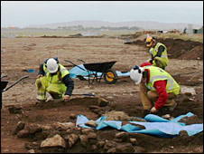 Archaeologist digging at the runway site