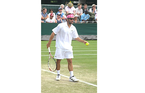 Talking of headgear, this is Arnaud Clement on Court 17. Pink - hmmm. And