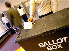 A vote is cast at a polling station