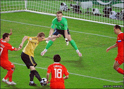 Fernando Torres fires an effort at Russia's keeper Igor Akinfeev