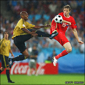 Spain's Marcos Senna and Roman Pavlyuchenko battle for the ball