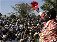 Robert Mugabe greets jubilant supporters at his final campaign rally on Thursday