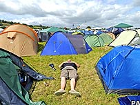 Festival goer enjoys the sunshine ahead of the 2008 Glastonbury Festival in Somerset