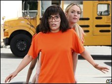 America Ferrera and Lindsay Lohan in Ugly Betty