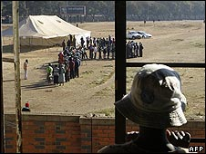 Man watches the queues of voters in Harare
