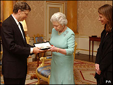 Bill Gates receives his knighthood from the Queen