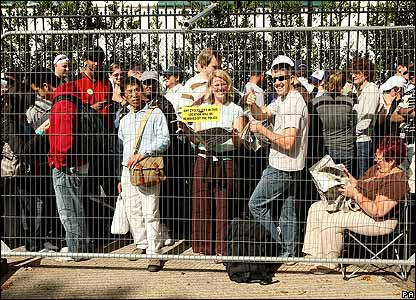 Tennis fans wait patiently to get access