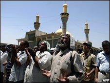 Shiite Iraqi Muslims pray towards Mecca during Friday noon prayers at a mosque in Kadhimiyah, northern Baghdad on June 27, 2008