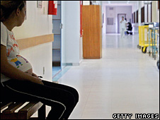 A pregnant girl waits in a hospital corridor (generic, file image)