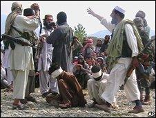 The Taleban prepare to kill the two captives