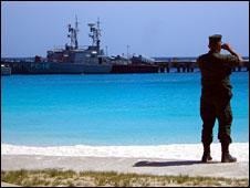 A Venezuelan soldier watches a military manoeuvre