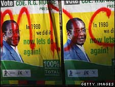 A Robert Mugabe poster with MDC scrawled on it