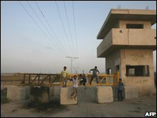 Children play at the closed border crossing of Karni, 26/06