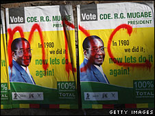 Robert Mugabe election posters in Harare carry grafitti with the opposition party's name, 27 June 2008
