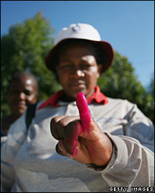 A voter shows her ink-stained finger in Harare, 27 June 2008
