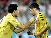 Cesc Fabregas and David Villa