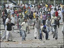 Stone-throwing protesters in Kashmir on 28 June 2008