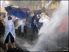Police use a water cannon against protesters in Seoul on 28 June 2008