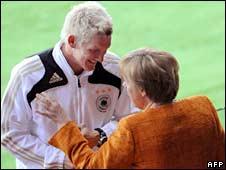 Footballer Bastian Schweinsteiger (left) Chancellor Angela Merkel at a stadium in Vienna on 16 June 2008