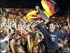 German fans celebrate in a Fan Mile in Berlin their team's win over Turkey on 25 June 2008