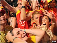 Spanish fans celebrate their team's victory over Russia in Madrid on 26 June 2008