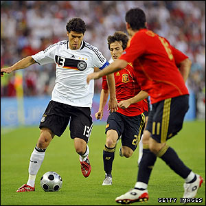 Germany's Michael Ballack threatens the Spanish defence