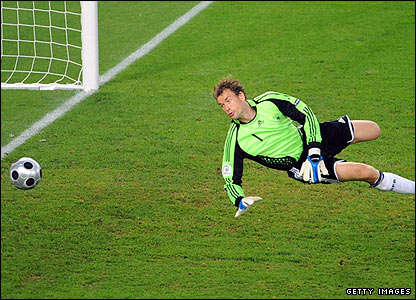 Jens Lehmann is called into action to save a deflected Andres Iniesta effort