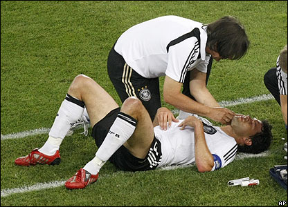 Ballack receives treatment off the pitch