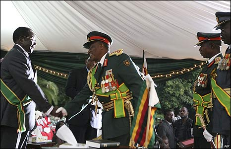 The commander of the defence forces congratulates Robert Mugabe on his inauguration as president