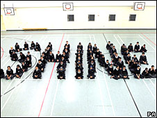 Students from Denbigh High School, Luton, spell out the word shine to help celebrate the launch of the Shine festival.